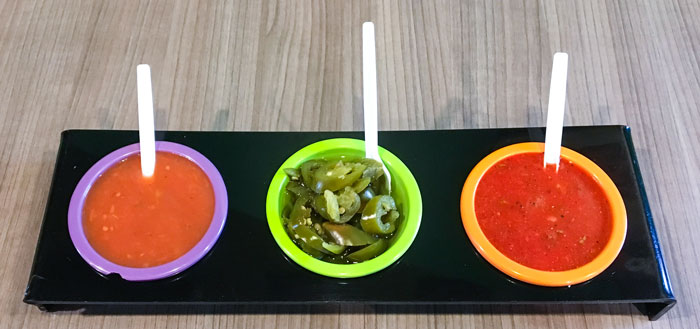 From Left: sweet sauce, jalapenos, super spicy salsa