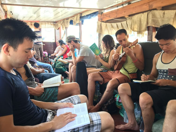 passengers on slow boat from Chiang Mai to Luang Prabang.